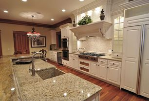 Traditional Kitchen with Raised panel, Breakfast bar, Kitchen island, Chandelier, Crown molding, 3 in. granite countertop