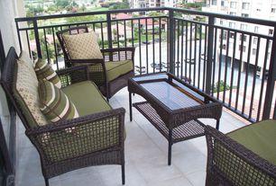 Modern Porch with exterior terracotta tile floors, exterior tile floors, Deck Railing, Wrap around porch