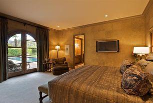 Mediterranean Guest Bedroom with Carpet, specialty door, Crown molding, Standard height, can lights