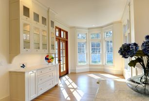 Traditional Bar with Hardwood floors, French doors