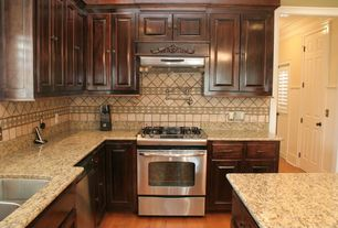 Traditional Kitchen with Simple Granite, Undermount sink, Kitchen island, Hardwood floors, Simple granite counters