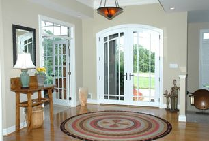 Traditional Entryway with can lights, Transom window, French doors, High ceiling, Bamboo floors, flush light, Crown molding