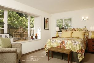 Eclectic Guest Bedroom with Wall sconce, Carpet