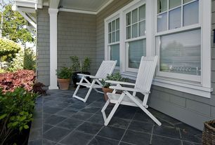 Cottage Porch with exterior tile floors, Wrap around porch