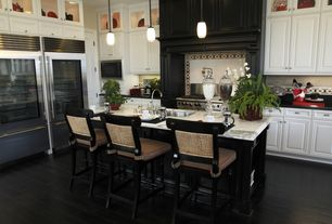 Traditional Kitchen with double oven range, Flat panel cabinets, Raised panel, specialty door, Limestone Tile, Stone Tile
