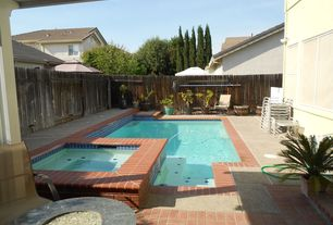 Traditional Swimming Pool with exterior brick floors, Pathway, Pool with hot tub, Fence