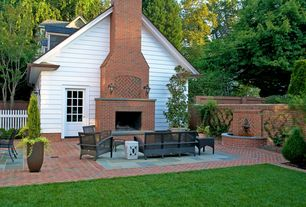 Traditional Patio with Fountain, Fence, Pond, Bird bath, exterior brick floors, Glass panel door