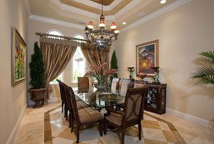 Traditional Dining Room with Chandelier, Crown molding, can lights, High ceiling, stone tile floors, Arched window