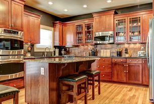Craftsman Kitchen with Standard height, full backsplash, Soapstone counters, electric cooktop, Stone Tile, Casement, Flush