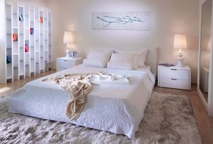 Contemporary Master Bedroom with Built-in bookshelf, Hardwood floors, French doors, High ceiling
