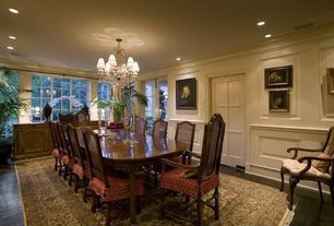 Traditional Dining Room with Carpet, Chandelier, Hardwood floors, Crown molding, Wainscotting, Concrete floors