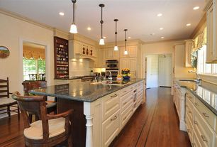 Traditional Kitchen with full backsplash, Framed Partial Panel, Hardwood floors, six panel door, Undermount sink, can lights