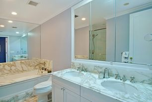 Traditional Master Bathroom with Complex Marble, Flat panel cabinets, Undermount sink, Crown molding, Double sink, Flush