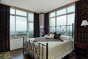 Traditional Master Bedroom with Hardwood floors, bedroom reading light, Transom window, Casement, Standard height