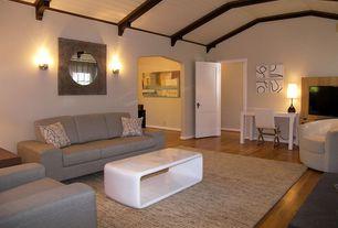 Living Room with Wall sconce, Exposed beam, Hardwood floors, specialty door