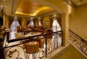 Mediterranean Living Room with Columns, Box ceiling, simple marble floors, sandstone tile floors, Kivett Sectional by Bauhaus