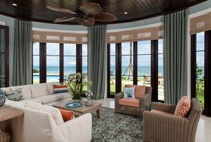 Tropical Living Room with Ceiling fan, Crown molding, Glass panel door, Concrete tile