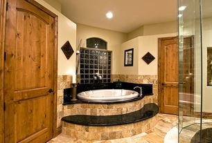 Rustic Master Bathroom with specialty door, slate tile floors, frameless showerdoor, flush light, Master bathroom