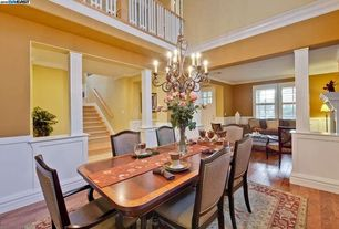 Traditional Dining Room with Claudine Dining Chair - Flax, Wainscotting, Columns, Crown molding, Chandelier, High ceiling