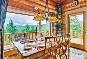 Rustic Dining Room with French doors, Balcony, Hardwood floors, Pendant light