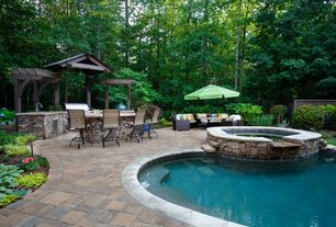 Traditional Patio with Trellis, outdoor pizza oven, Outdoor kitchen, Pathway, Raised beds, exterior stone floors