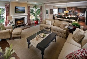 Traditional Living Room with Fireplace, Standard height, can lights, picture window, Cement fireplace, double-hung window