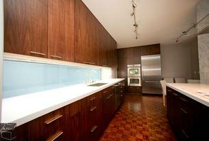"Contemporary Kitchen with European Cabinets, White quartz countertop in ""snowstorm"", Destiny: slab cabinets, Corian counters"