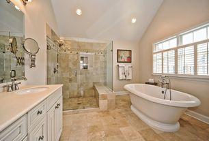 Traditional Master Bathroom with frameless showerdoor, picture window, Freestanding, Limestone counters, Limestone, Casement