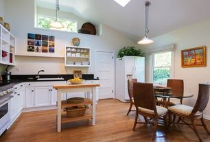 Country Kitchen with Flush, Flat panel cabinets, Breakfast nook, Soapstone counters, High ceiling, Kitchen island, Soapstone