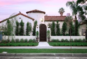 Mediterranean Exterior of Home with exterior concrete tile floors, Casement, Fence, exterior tile floors, Pathway