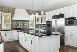 Traditional Kitchen with Kitchen island, Pendant light, Flat panel cabinets, Soapstone counters, Raised panel, U-shaped