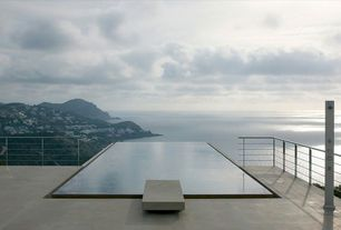 Modern Swimming Pool with Infinity pool, exterior tile floors