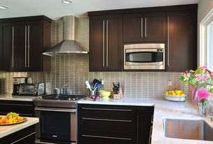 Contemporary Kitchen with Standard height, Undermount sink, gas range, full backsplash, Glass Tile, Flat panel cabinets