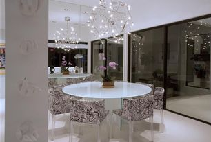 Contemporary Dining Room with Chandelier, Columns, Balcony