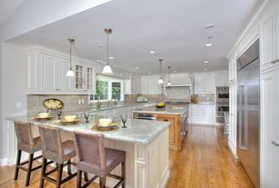 Traditional Kitchen with Framed Partial Panel, Flat panel cabinets, Casement, Built In Refrigerator, Glass panel, Stone Tile