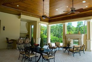 Traditional Porch with Columns, High ceiling, Brick floors, Crown molding, Ceiling fan