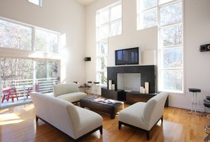 Contemporary Living Room with Casement, brick fireplace, Laminate floors, sliding glass door, High ceiling, Fireplace