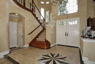 Eclectic Entryway with picture window, Cathedral ceiling, six panel door, Glass panel door, Casement, Chandelier, can lights