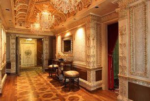 Traditional Hallway with Chair rail, High ceiling, Chandelier, specialty door, Wainscotting, flush light, Hardwood floors