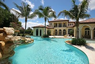 Mediterranean Swimming Pool with Transom window, exterior stone floors, Raised beds, French doors, Arched window