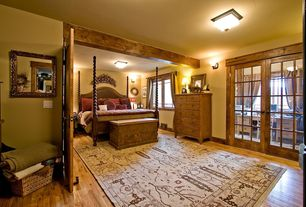 Craftsman Master Bedroom with Wall sconce, Casement, Hardwood floors, flush light, French doors, Standard height