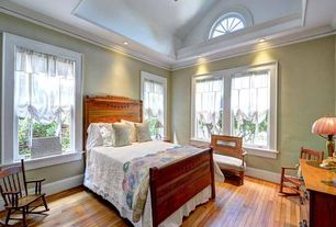 Country Master Bedroom with Crown molding, High ceiling, specialty window, Built-in bookshelf, Hardwood floors, can lights