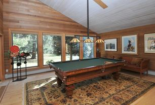 Country Game Room with High ceiling, Pendant light, Laminate floors