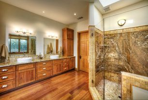 Traditional Master Bathroom with Wall sconce, Flat panel cabinets, Complex granite counters, frameless showerdoor, Stone Tile