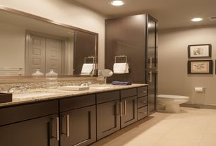 Contemporary Master Bathroom with can lights, Undermount sink, specialty door, Double sink, stone tile floors, Inset cabinets