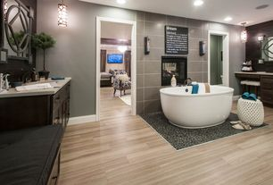 Modern Master Bathroom with Kohler Sunstruck Freestanding Baths with Three Faucet Holes, High ceiling, Flat panel cabinets