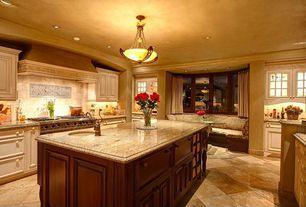 Traditional Kitchen with Glass panel, Undermount sink, Raised panel, Flush, Bay window, Window seat, Stone Tile, U-shaped