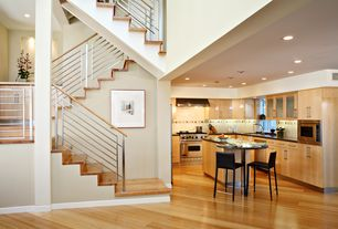 Modern Staircase with Hardwood floors, High ceiling, Columns, Floating staircase