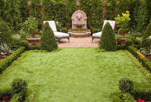 Traditional Landscape/Yard with Pond, Bird bath, Green Velvet Boxwood, Fence, Fountain, Raised beds, exterior stone floors