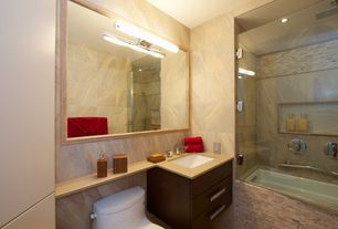 Modern Full Bathroom with Standard height, drop in bathtub, Rain shower, frameless showerdoor, Simple marble counters, Shower